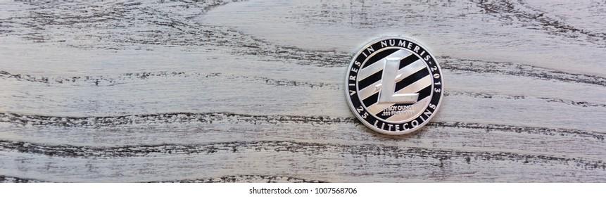 Silver Litecoin on wooden background