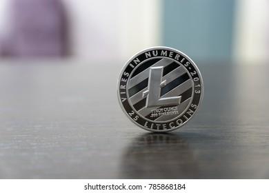 Silver Litecoin on wooden desk