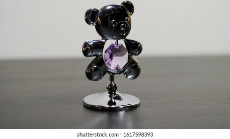 Silver little statue in the form of a bear with jewelry similar to a diamond