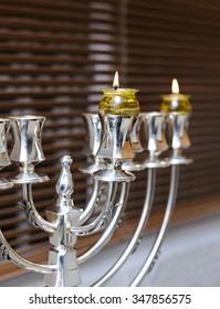 silver Menorah Hanukkah With olive oil