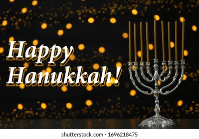 Silver menorah on black table. Happy Hanukkah!
