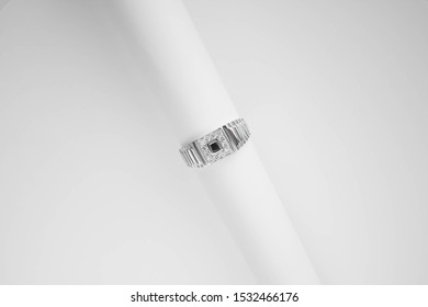 Silver men's ring signet. With white and black stones. On white background.