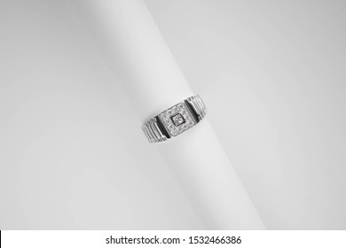 Silver men's ring signet. With white  stones. On white background.