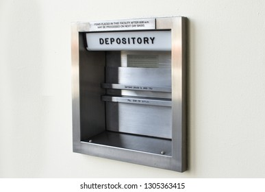Silver Metal Bank Depository Box on Concrete Wall