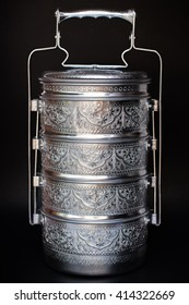 Silver metal carrier tiffin with ancient texture (Food Container) isolated on  black background