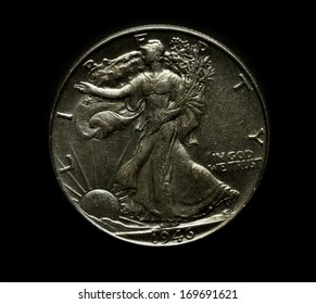 silver metal coin money isolated black background
