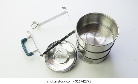 Silver Metal Color Tiffin, Food Container or Food Carrier. Isolated on white background. Slightly de-focused and close-up shot. Copy space.