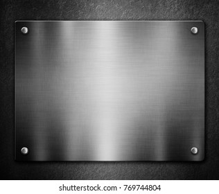 Silver metal plaque on black background