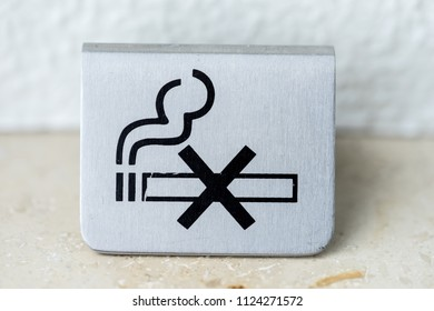 Silver metal sign - No smoking