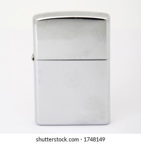 Silver metal zippo lighter for smoking, closeup, macro, copy space, isolated on white