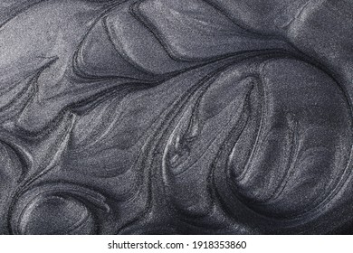 Silver metallic abstract background. Make up concept.Beautiful stains of liquid nail laquers.Fluid art,pour painting technique.Horizontal banner,can be used as backdrop for chat.