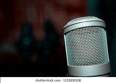 silver microphone in broadcasting studio