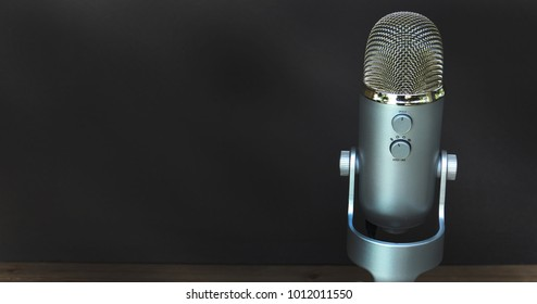 silver microphone isolated on black background