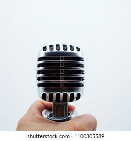 Silver microphone on white background, Microphone holder To sing