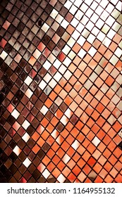 Silver Mosaic pattern of tiles at the Thai temple. Glass Wall of Thai Temple. Wall is decorated with stained glass small plate Traditional Thai mosaic art.