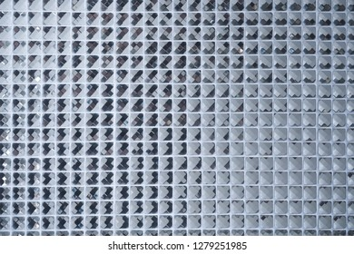 Silver Mosaic pattern of tiles.Wall is decorated with stained glass small plate ,Beautiful mosaic wall or ceramic wall for pattern background