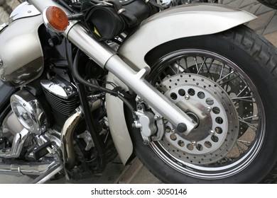 Silver motorbike engine detail, close-up