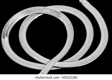 Silver necklace on a black background