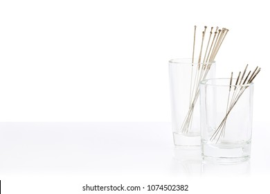 Silver needles for traditional Chinese medicine acupuncture. Close-up. White background. There is some free space for your text or sign.