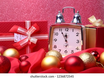 Silver New year clock with many balls on abstract background, Christmas decoration