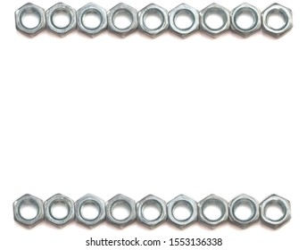 silver nuts on a white background located in a row on both sides of the image. isolate.Flat lay