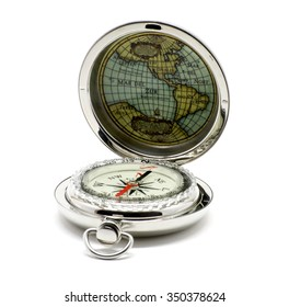 Silver open isolated compass with map over white
