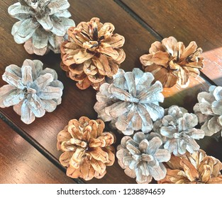 Silver painted and natural pinecones.