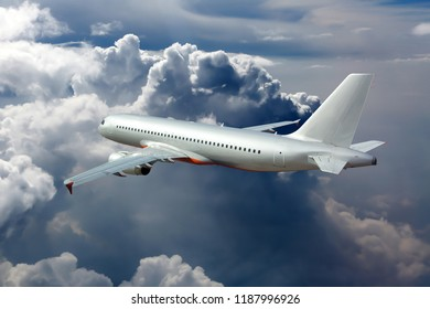 Silver passenger plane fly away. Back view of aircraft.
