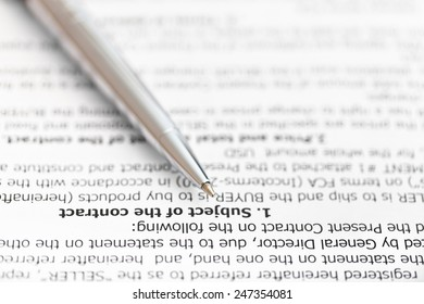 silver pen on page of sales contract close up