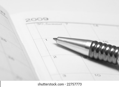 silver pen with opened notebook