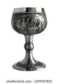 Silver or pewter wine goblet bas-relief and Latin inscription - In Vino Veritas. Photo with a shallow depth of field