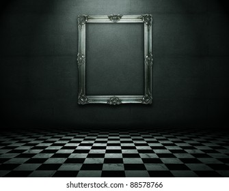 Silver picture frame in grunge empty interior with clipping path for the inside
