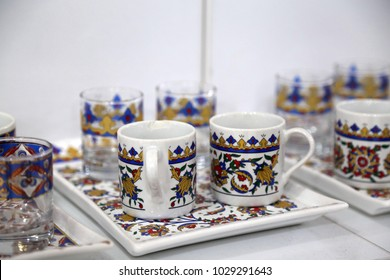 silver and porcelain coffee cups
