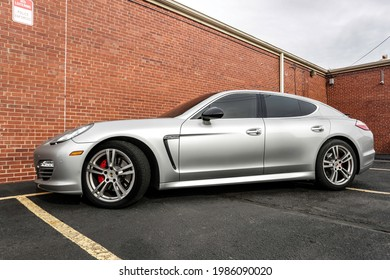 Silver Porsche Panamera on Brick Wall