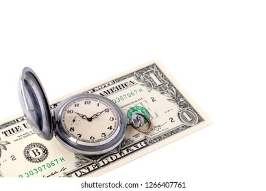 Silver retro pocket watches lie on the banknote of one US dollar. The concept of saving time, profit, effective time management. Copy space. Isolated.