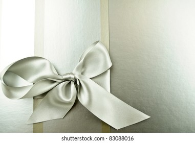 silver ribbon  on a silver background