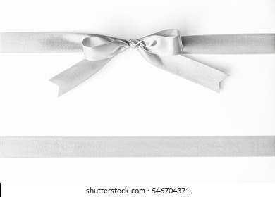 Silver ribbon pearl satin stripe band fabric bow isolated on white background with clipping path