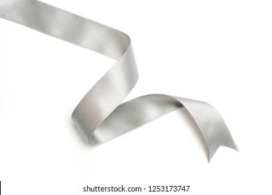 Silver ribbon in roll on white background