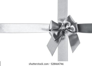 Silver ribbons and bow isolated on the white background