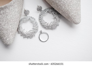 Silver ring and earrings with shoes