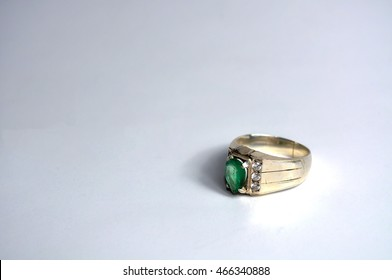 Silver ring with green stone in white background