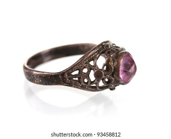 Silver ring with pink gemstone isolated on white
