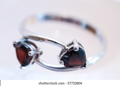 Silver ring with pomegranates in the form of hearts