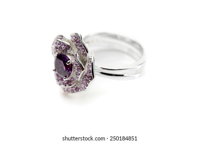 Silver ring with a purple stone isolated on white background
