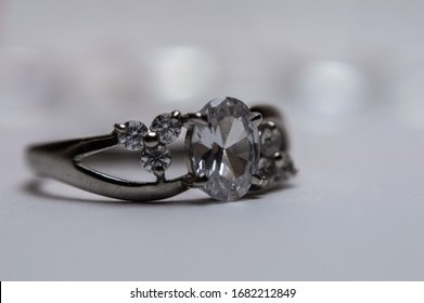 Silver ring with stones on blurred background