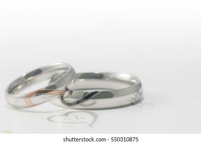 Silver ring in valentine day on the calendar.