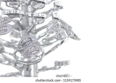 Silver rings with CZ baguette shape on casting tree,isolated white background.
