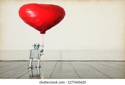 silver  robot holding red balloon standing on old wooden floor  copy space