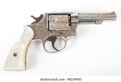 silver rusty old pistol isolated on white background