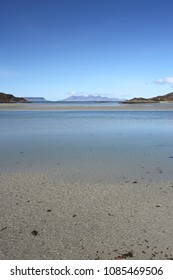 Silver sands at Morar looking towards the Isles of Eigg and Rum on a beautiful spring morning in Lochaber.